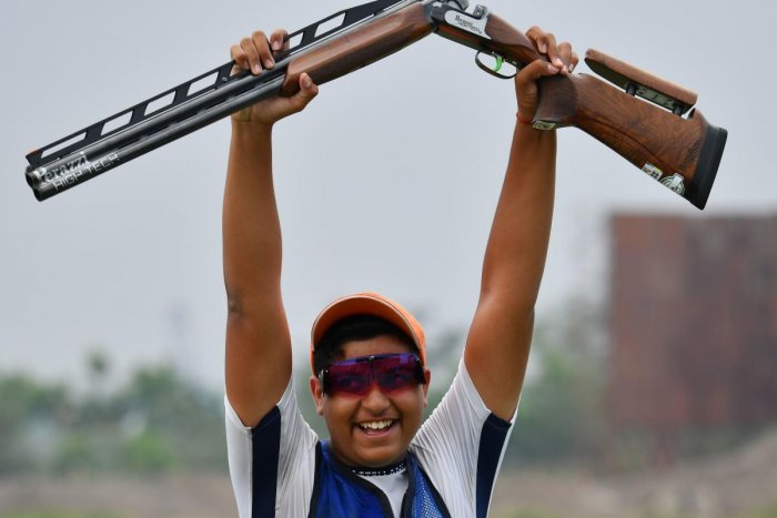 FINE SHOW: India's Shardul Vihan celebrates after clinching silver in the men's double trap shooting final in on Thursday. AFP