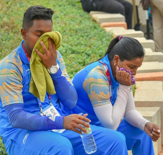Indian archers Deepika Kumari (right) and Atanu Das look dejected after going down in the recurve in mix team event at the Asian Games on Friday. PTI