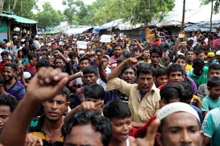 Rohingya refugees shout slogans as they take part in a protest at the Kutupalong refugee camp to mark the one year anniversary of their exodus in Cox's Bazar, Bangladesh August 25, 2018. REUTERS/Mohammad Ponir Hossain