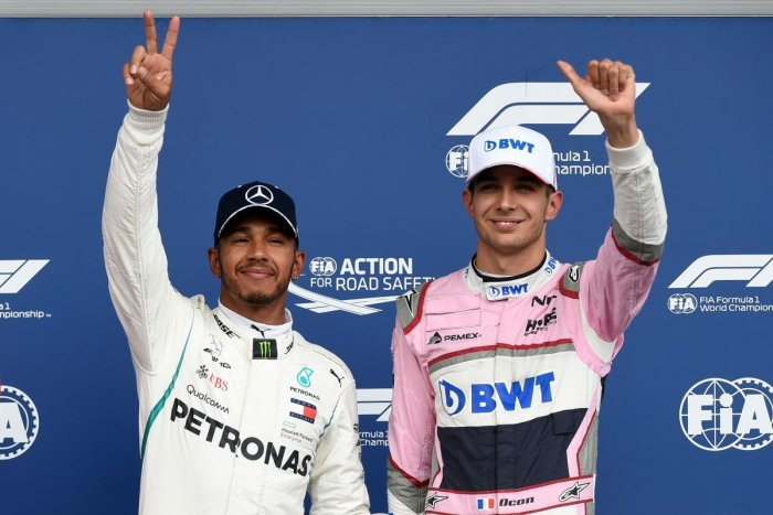 MEMORABLE: Mercedes' Lewis Hamilton (left) celebrates winning the pole position next to third placed Racing Point Force India's Esteban Ocon. AFP