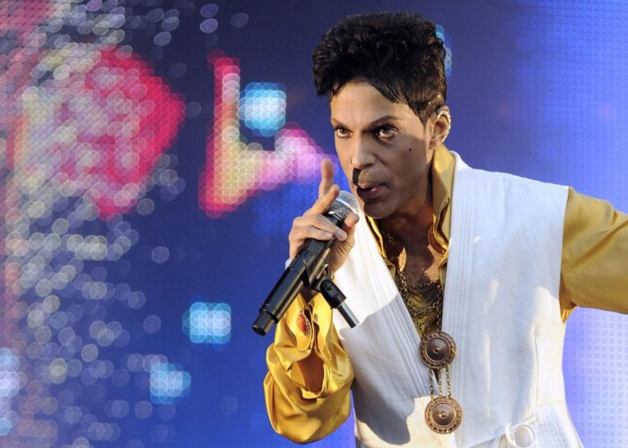 This June 30, 2011 file photo shows US singer and musician Prince performing on stage at the Stade de France in Saint-Denis, outside Paris. AFP