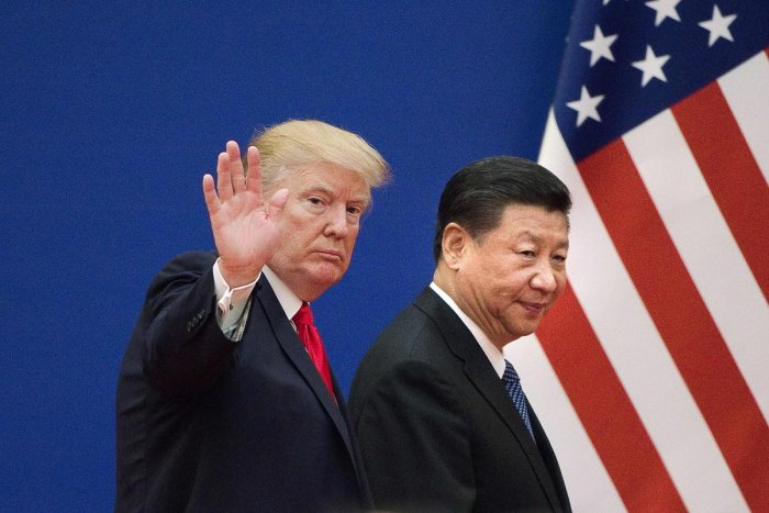 US President Donald Trump and China's President Xi Jinping at the Great Hall of the People in Beijing on November 9, 2017. AFP