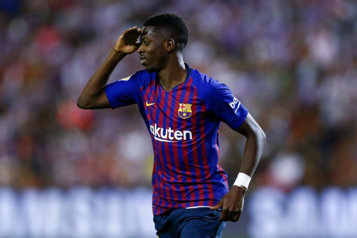 Barcelona's Ousmane Dembele celebrates after scoring against Real Valladolid in Valladolid on Sunday. AFP