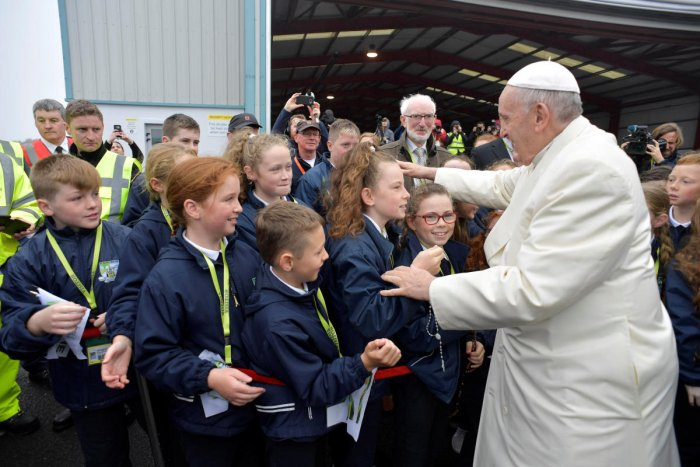 Pope Francis greets children after arriving in Knock, Ireland August 26, 2018. Vatican Media/Handout via REUTERS