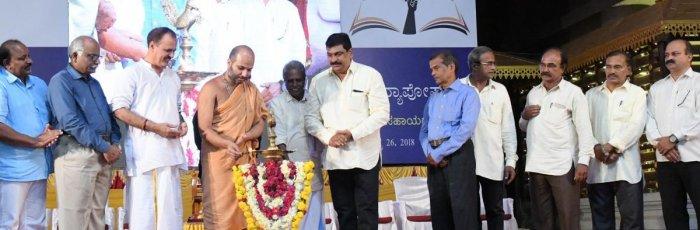 Admaru Mutt junior seer Eshapriya Swami inaugurates a programme organised to give away Vidyaposhak scholarships to the meritorious students in Udupi on Sunday.