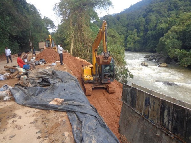 Construction of temporary retaining wall in progress on Shiradi Ghat stretch.