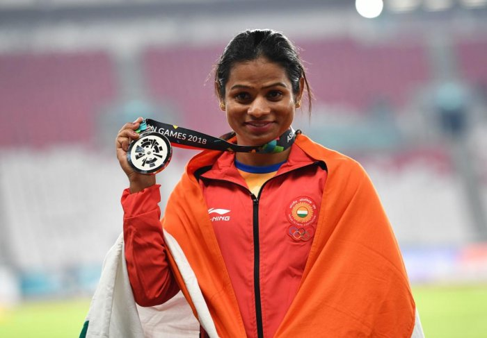 India's Dutee Chand celebrates after clinching silver in the women's 100m on Sunday. AFP