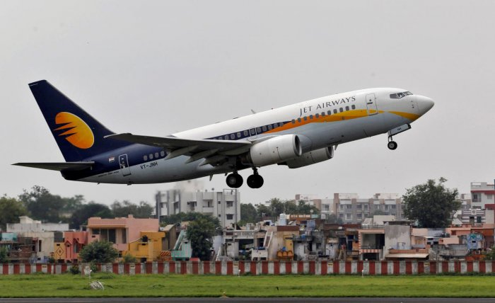 FILE PHOTO: A Jet Airways passenger aircraft takes off from the airport in the western Indian city of Ahmedabad, India, August 12, 2013. REUTERS/Amit Dave/File Photo
