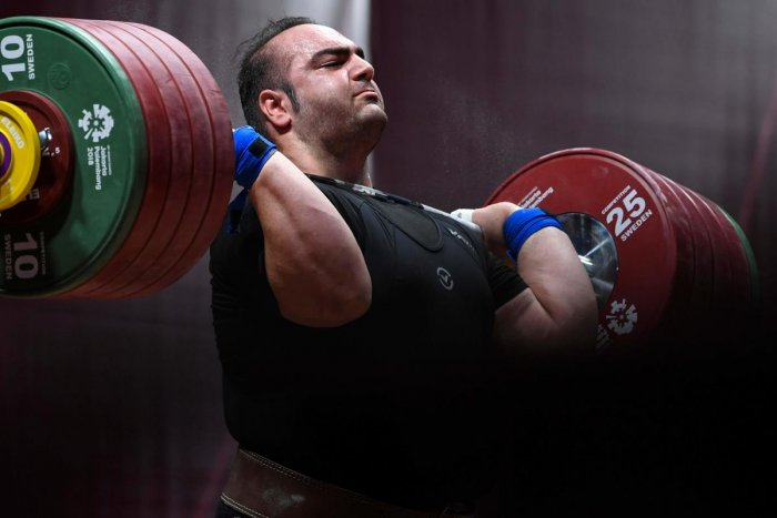 Iran's Behdad Salimikordasiabi attempts a lift during the men's snatch +105kg weightlifting group 'A' event. AFP