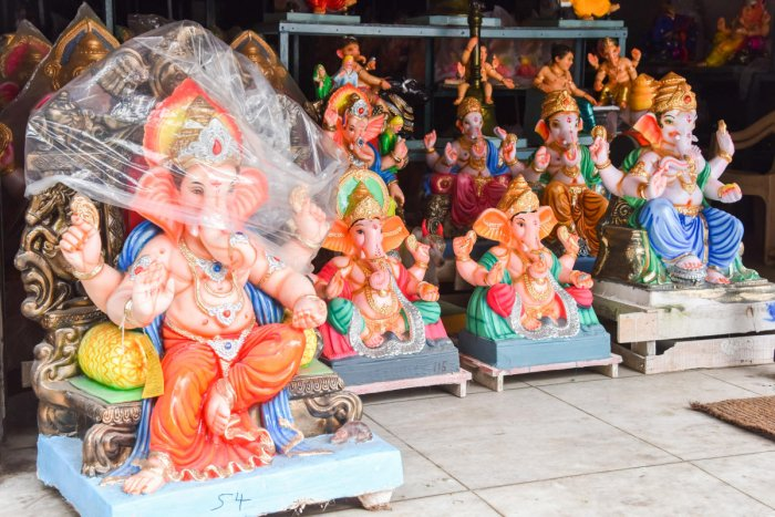 Mud Ganesha idols are placed for sale for coming Ganesha festival at RV Road in Bengaluru on Monday. Photo by S K Dinesh