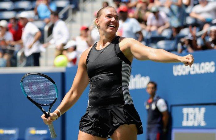 Kaia Kanepi of Estonia celebrates her win over Simona Halep of Romania on Monday. AFP