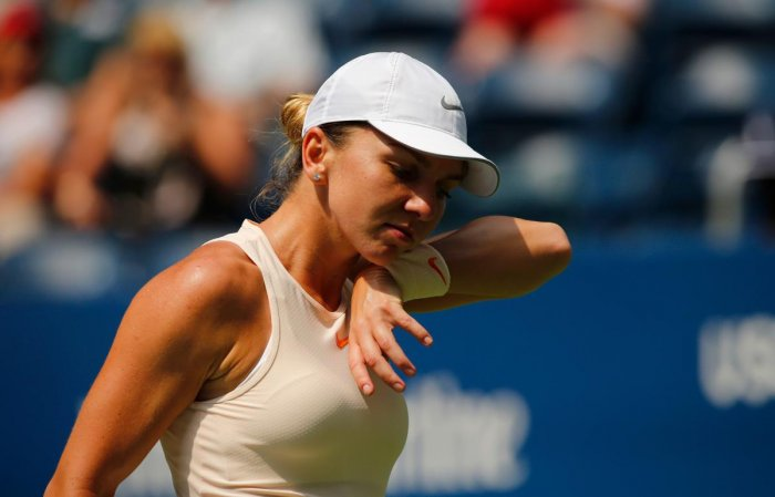 SHOCK EXIT: Number one seeded Simona Halep of Romania admitted she wasn't at the top of her game against Kaia Kanepi of Estonia. AFP