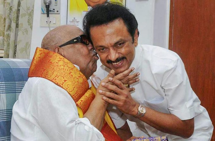 The then DMK working president M K Stalin with his father and party president M Karunanidhi. (PTI File Photo)
