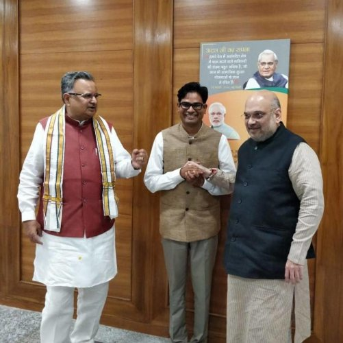 The photo tweeted by O P Choudhary, of him with BJP chief Amit Shah and Chhattisgarh Chief Minister Raman Singh. Twitter