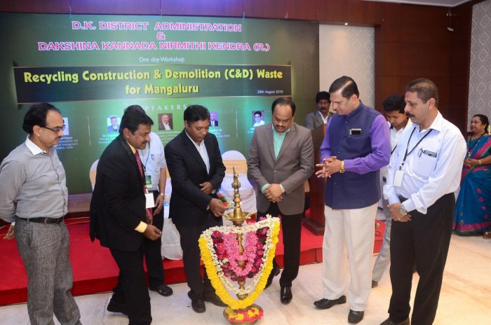 Deputy Commissioner Sasikanth Senthil inaugurates a one-day workshop on 'Recycling Construction and Demolition Waste for Mangaluru' on Tuesday. Government of India Department of Science and Technology Fly Ash Research and Management (C-FARM) former director Dr Vimal Kumar, NITK Department of Civil Engineering Professor Katta Vekataramana, Nirmithi Kendra Director Rajendra Kalbavi, Zilla Panchayat CEO Dr M R Ravi and others look on.