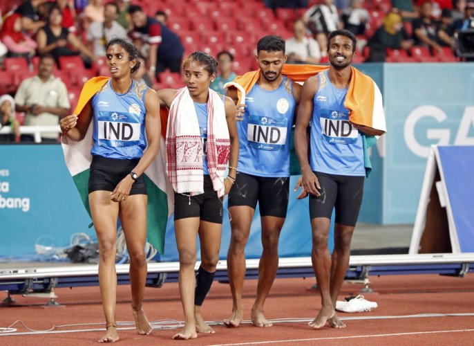 MR Poovamma, Hima Das, Muhammed Anas and Arokia Rajiv (from left) of India celebrate after finishing second in the mixed 4x400M relay in Jakarta on Tuesday. Reuters