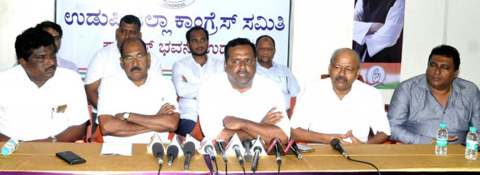 Urban Development Minister U T Khader speaks to reporters in Udupi on Tuesday.