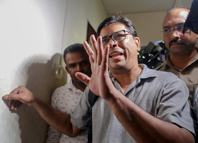 Arun Ferreira, a human rights activist and lawyer, after he was arrested by the Pune police in connection with Bhima Koregaon violence case, in Mumbai. PTI Photo
