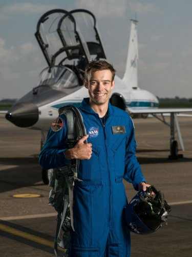 This handout photo released by NASA shows 2017 NASA Astronaut Candidate Robb Kulin on the tarmac by Hangar 276 in Ellington Field, Houston, Texas, on June 6, 2017. (Photo by Robert Markowitz - NASA - Johnso and Handout / NASA / AFP)
