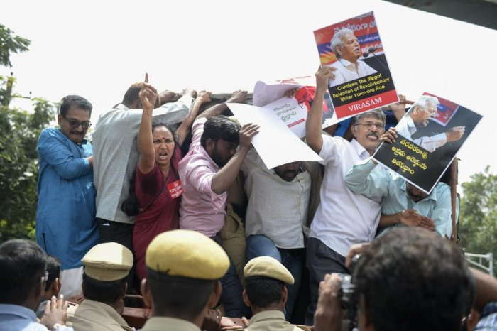 Activists of the Communist Party of India shout slogans during a protest against the arrest of poet and activist Varavara Rao in Hyderabad. AFP Photo
