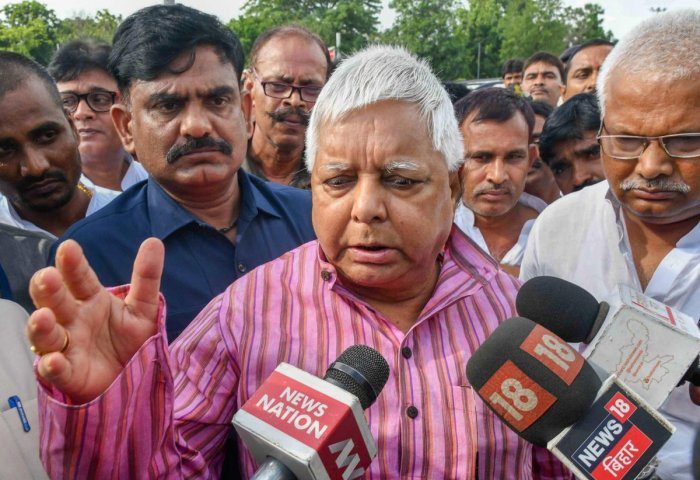 Rashtriya Janata Dal (RJD) Chief Lalu Prasad Yadav talks to the media as he leaves for Ranchi after the expiry of his granted bail, in Patna. PTI Photo