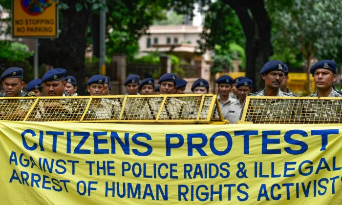 Delhi Police personnel stand on duty as activists from various organisations stage a protest pertaining to the arrest of five activists, in connection with the Bhima-Koregaon protests, in New Delhi. PTI Photo