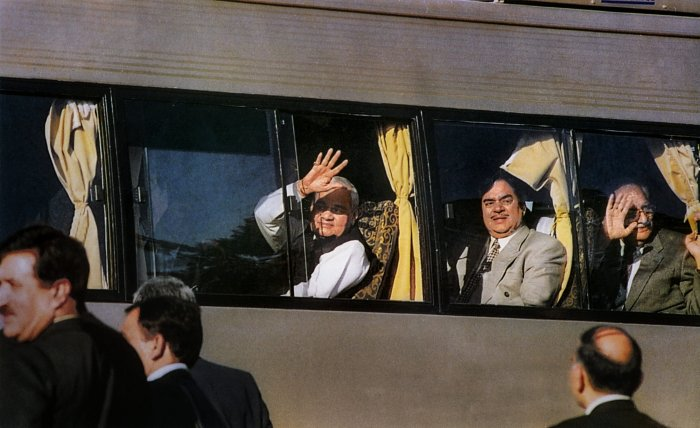 Former prime minister Atal Bihari Vajpayee waves from the maiden Delhi-Lahore bus service on his arrival at Lahore to attend a summit. (PTI File Photo)