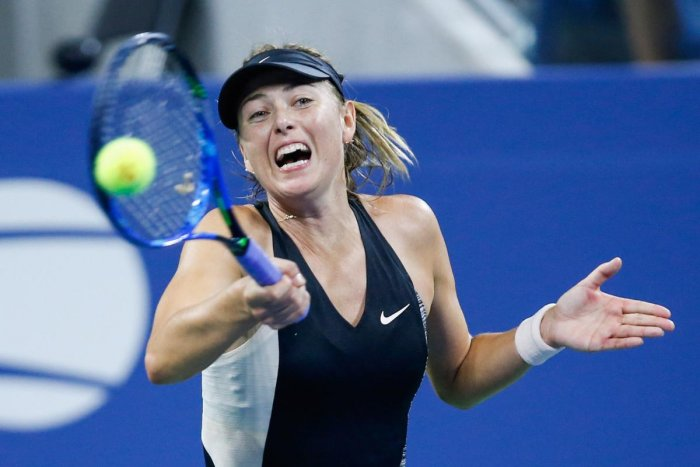 GRINDING OUT: Maria Sharapova of Russia returns during her first round win ovre Patty Schnyder of Switzerland in New York on Wednesday. AFP