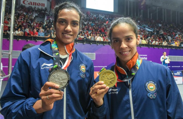 GOOD SHOW: Indian silver medalist PV Sindhu (left) and Saina Nehwal with her bronze medal in Jakarta, Indonesia on Tuesday. (PTI Photo)