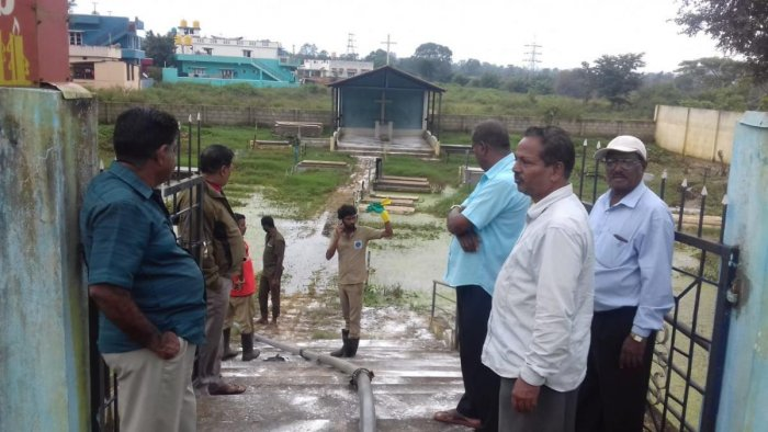 Water being drained out of a burial place at Shantidhama in Kushalnagar.