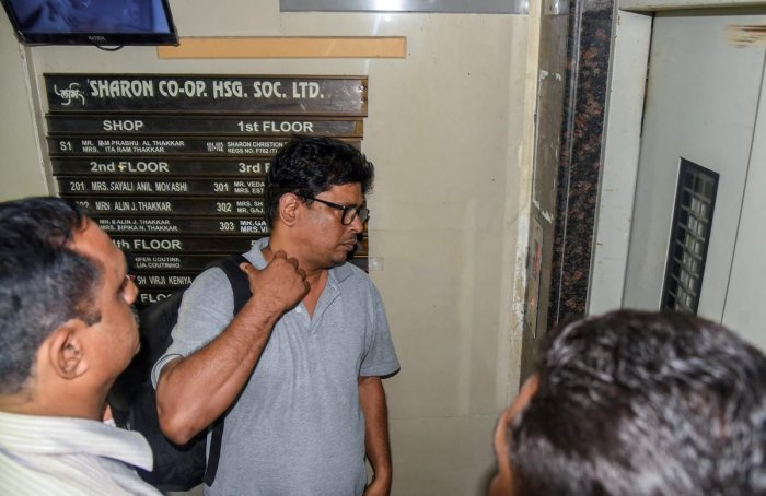 Social activist-lawyer Arun Ferreira looks on after he was brought back to his residence and placed under house arrest, in Thane on Thursday, Aug 30, 2018. Supreme Court gave relief to Ferreira and four other rights activists, who were arrested for their alleged role in Bhima-Koregaon violence. PTI