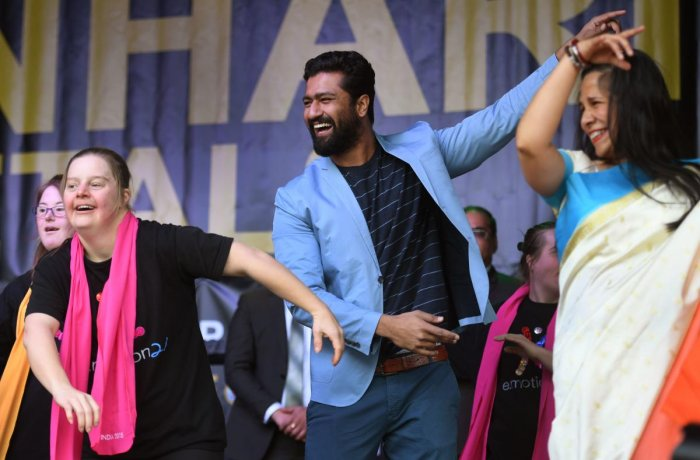 Vicky Kaushal (C) dances on stage with performers in Federation Square at the Indian Film Festival of Melbourne on August 11, 2018. (Photo AFP)