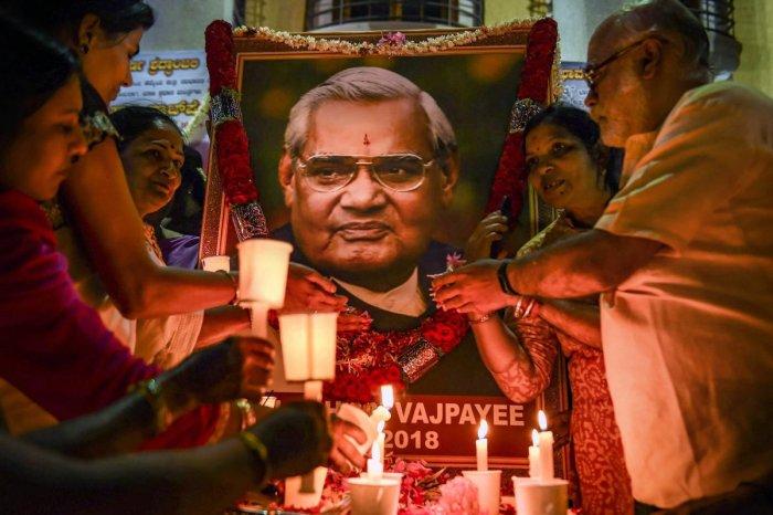 BJP workers pay tribute to former prime minister Atal Bihari Vajpayee, in Bengaluru. (PTI File Photo)