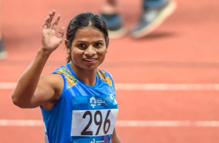 India's Dutee Chand reacts after winning the Silver medal in the women's 200m final event at the 18th Asian Games 2018 in Jakarta, Indonesia on Wednesday, Aug 29, 2018. PTI Photo