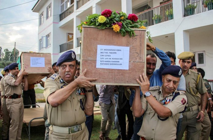 Director General of Jammu and Kashmir Police SP Vaid along with ADGP Munir Khan, IG SP Pani and others carry the bodies of four policemen who were killed in a militant attack on a police party, in Shopian district of South Kashmir on Wednesday. PTI