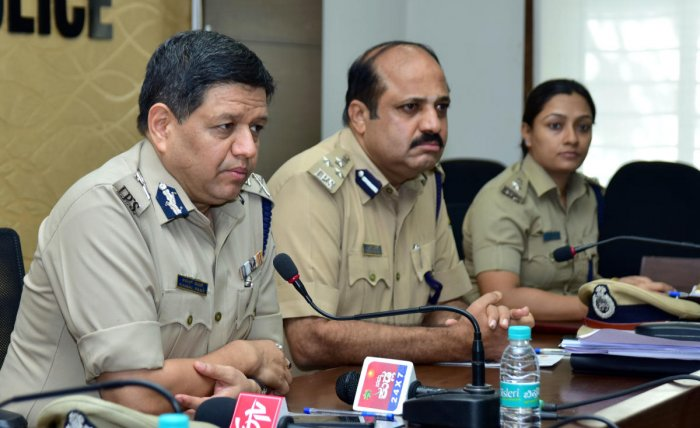 Karnataka Additional Director General of Police Kamal Pant interacts with reporters at Mangaluru City Police Commissionerate office on Thursday. Commissioner of Police T R Suresh and DCP (Crime and Traffic) Uma Prashanth look on.