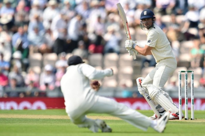 England's Alastair Cook watches as he is caught by India captain Virat Kohli on the opening day of the fourth Test in Southampton on Thursday. AFP