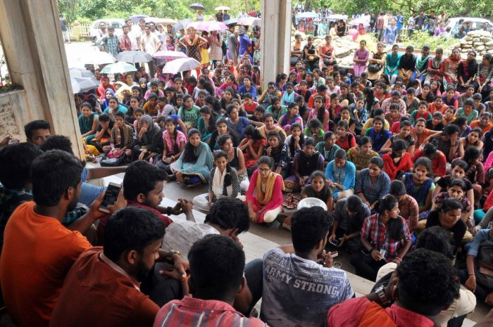 Students of Mangalore University stage a sudden protest in front of the Administrative Block of the University in Mangalagangothri on Thursday.