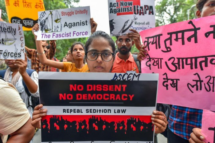 Activists of Jan Ekta Jan Adhikar Andolan' display placards during a protest against the arrests of activists and alleged state repression, in New Delhi on Thursday. PTI