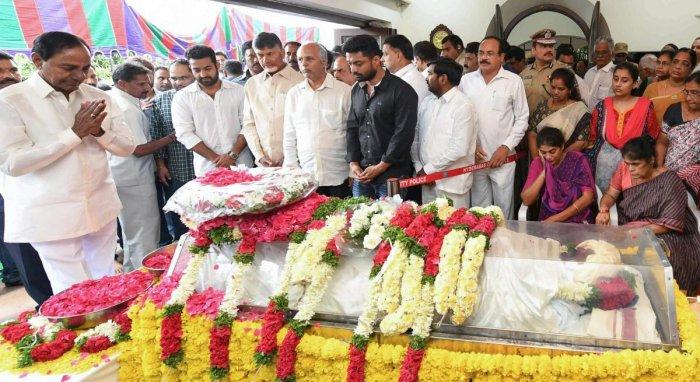 Telangana Chief Minister K Chandrashekar Rao with Andhra Pradesh Chief Minister N Chandrababu Naidu pay their tribute to former Rajya Sabha MP Nandamuri Harikrishna, who died due to a road accident in Nalgonda, in Hyderabad on Wednesday, Aug 29, 2018. PTI