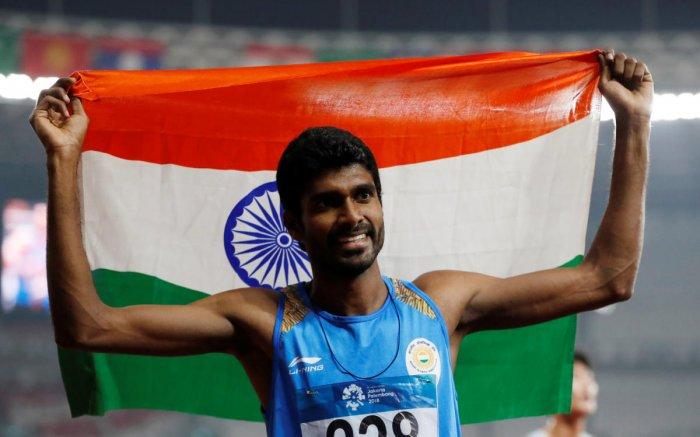 India's Jinson Johnson celebrates after the race. (Reuters Photo)