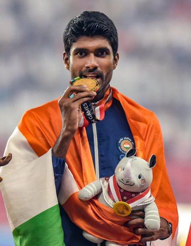 India's Jinson Johnson celebrates his gold medal winning effort in the men's 1500 metres. PTI