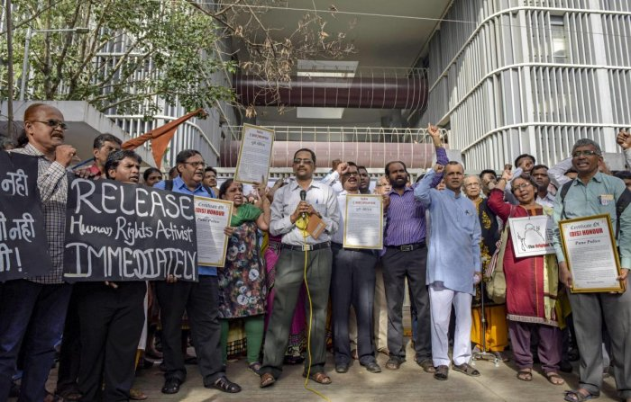 A group of activists protest against the recent arrest of 5 rights activist by the Pune Poilce, at Pune Collectorate on Thursday, August 30, 2018. (PTI Photo)