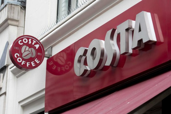 (FILES) In this file photo taken on November 15, 2017 the Costa coffee logo is pictured above a Costa coffee shop in London. AFP
