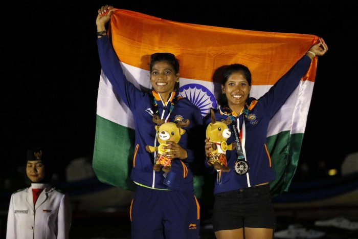 2018 Asian Games - 49er FX Women Race 15 victory ceremony - Indonesia National Sailing Center - Jakarta, Indonesia - August 31, 2018 - Silver medalists Gautham Varsha and Shervegar Sweta of India pose. REUTERS