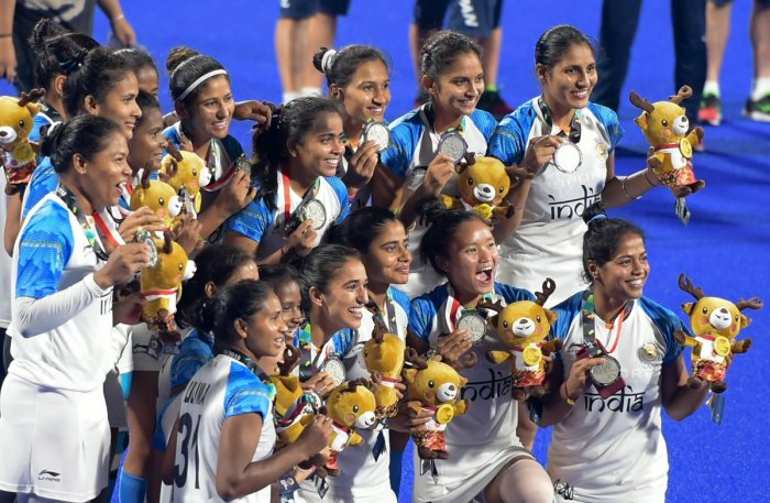 SECOND BEST: Indian women's hockey players celebrate their silver winning effort in Jakarta on Friday. PTI
