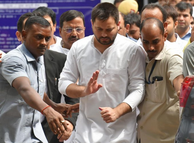 Former Bihar deputy chief minister Tejashwi Yadav comes out of the Patiala House court after appearing before a special court in the (IRCTC) tender scam case, in New Delhi on Friday. (PTI)
