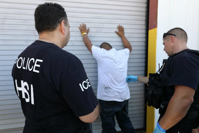 U.S. Immigration and Customs Enforcement's (ICE) Homeland Security Investigations (HSI) officers execute criminal search warrants and arrest more than 100 company employees on federal immigration violations at a trailer manufacturing business in Sumner, T