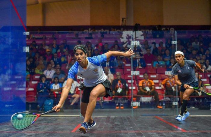 GIANT SLAYER: India's Joshna Chinappa (left) during her team's semifinal match against Malaysia's Nicol David in Jakarta on Friday. Joshna won 12-10, 11-9, 6-11, 10-12, 11-9. PTI