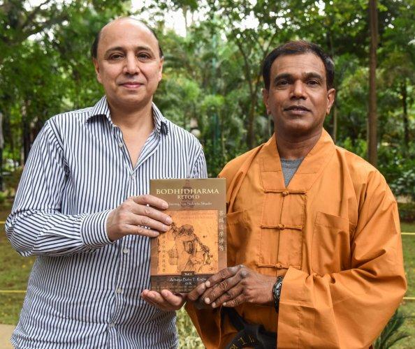 Author Arvind Johar with Acharya Babu T Raghu at a press meet in Bengaluru on Friday. DH Photo/S K Dinesh